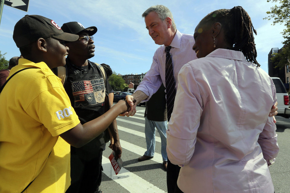 Democratic mayoral hopeful Bill de Blasio, center, and wife Chirlane McCray, right greet a supporters after a campaign rally in the Brooklyn borough of New York, Saturday, Sept. 7, 2013. The Democratic primary election is Tuesday, Sept. 10. (AP Photo/Mary Altaffer)