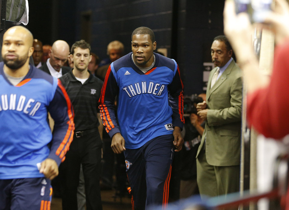 Photo - Kevin Durant takes the court before Game 3 in the first round of the NBA playoffs between the Oklahoma City Thunder and the Memphis Grizzlies at FedExForum in Memphis, Tenn., Thursday, April 24, 2014. Photo by Bryan Terry, The Oklahoman