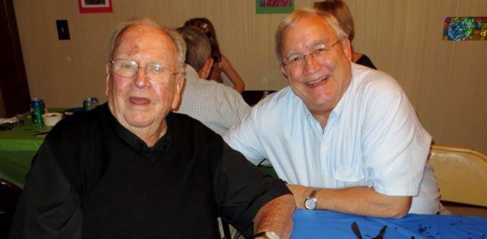 Father Paul Gallatin and Bill Brown enjoy the event. (Photo by Helen Ford Wallace).