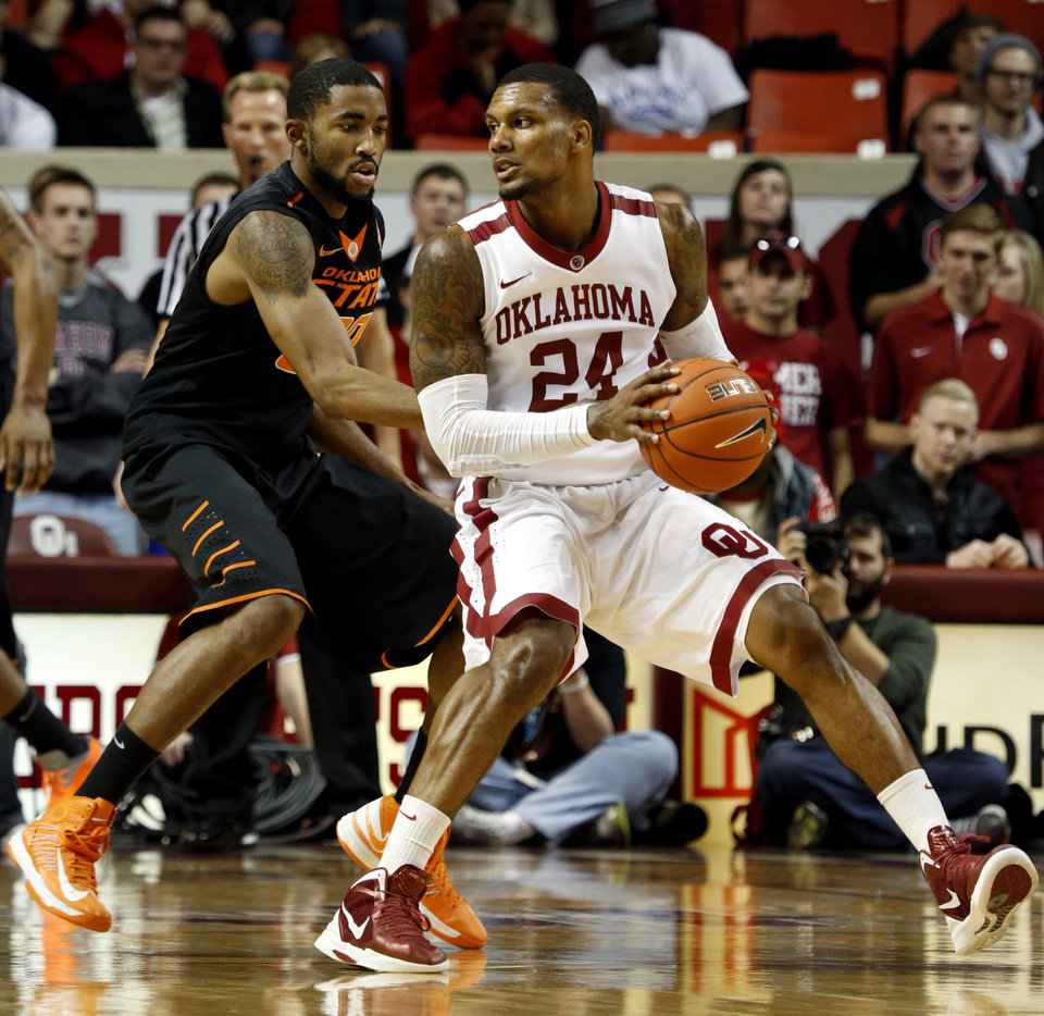 Sooner\'s Romero Osby (24) is guarded by Cowboy\'s Michael Cobbins (20) as the University of Oklahoma Sooners (OU) play the Oklahoma State Cowboys (OSU) in NCAA, men\'s college basketball at The Lloyd Noble Center on Saturday, Jan. 12, 2013 in Norman, Okla. Photo by Steve Sisney, The Oklahoman