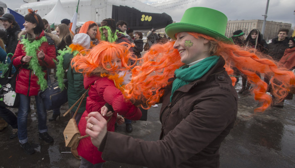 Photo - People dance during a St. Patrick's Day Parade in Moscow, Russia, Saturday, March 16, 2013. (AP Photo/Misha Japaridze)