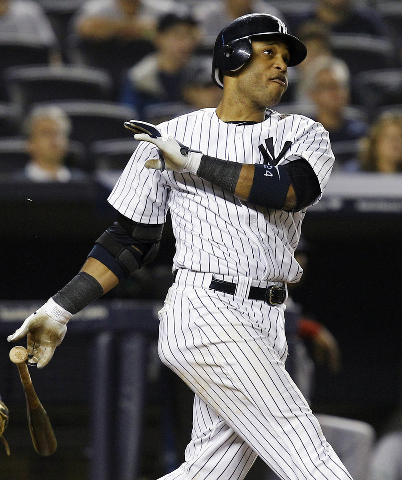 Photo -   New York Yankees' Robinson Cano watches his fifth-inning, two-run home run during their baseball game against the Boston Red Sox at Yankee Stadium in New York, Wednesday, Oct. 3, 2012. Alex Rodriguez also scored. (AP Photo/Kathy Willens)