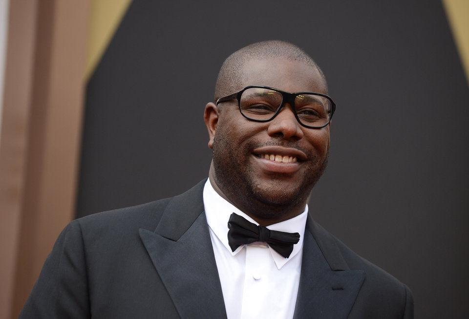 Photo - Director Steve McQueen arrives at the Oscars on Sunday, March 2, 2014, at the Dolby Theatre in Los Angeles.  (Photo by Jordan Strauss/Invision/AP)