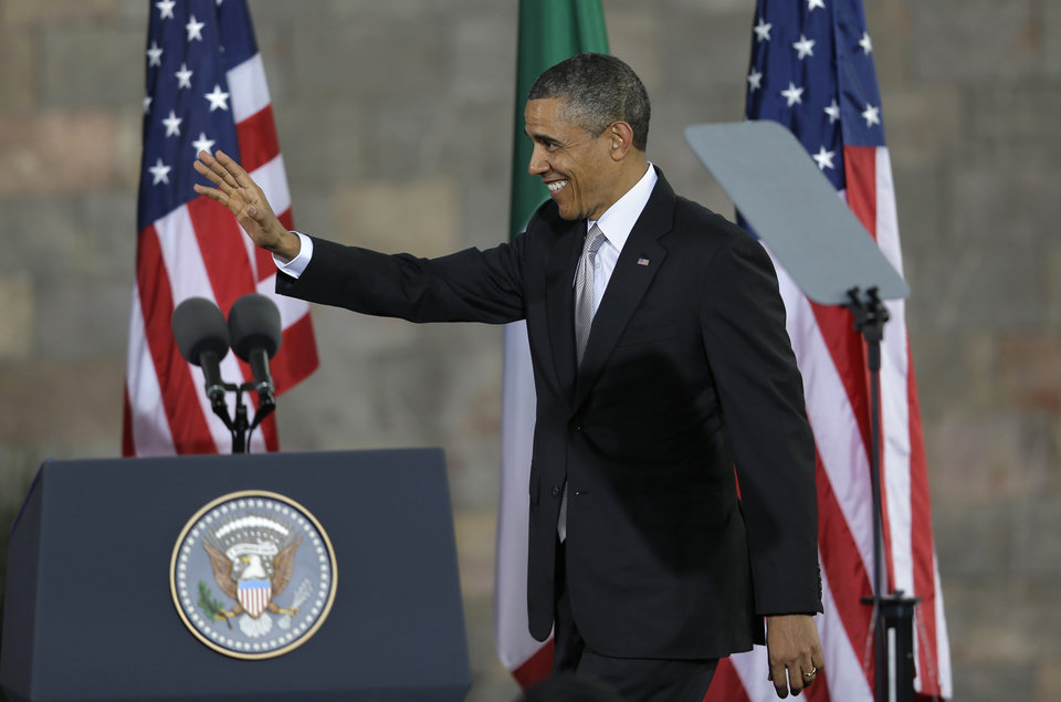 Photo - President Barack Obama waves as he arrives to speak at the Anthropology Museum in Mexico City, Mexico, Friday, May 3, 2013.  Obama said he is optimistic that the U.S. will change its patchwork of immigration laws and that the current immigration system does not reflect U.S. values. With about 6 million Mexicans illegally in the United States, the issue resonates deeply in Mexico, which has also seen deportations of its citizens from the U.S. rise dramatically under Obama. (AP Photo/Dario Lopez-Mills)