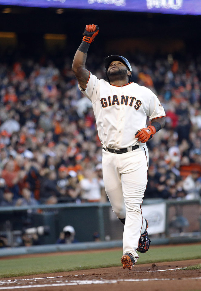 Photo - San Francisco Giants third baseman Pablo Sandoval celebrates a solo home run against Minnesota Twins in the second inning of a baseball game Saturday, May 24, 2014, in San Francisco. (AP Photo/Tony Avelar)