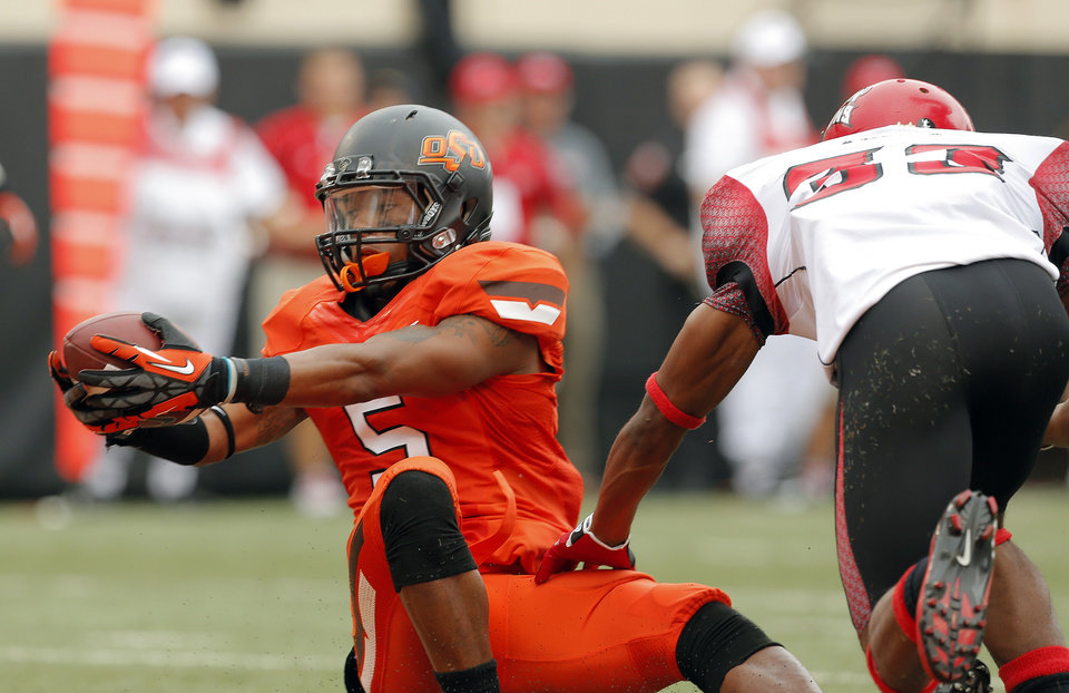 Oklahoma State\'s Josh Stewart (5) stretches for a touchdown as Louisiana-Lafayette\'s Trevence Patt (33) defends during a college football game between Oklahoma State University (OSU) and the University of Louisiana-Lafayette (ULL) at Boone Pickens Stadium in Stillwater, Okla., Saturday, Sept. 15, 2012. Photo by Sarah Phipps, The Oklahoman