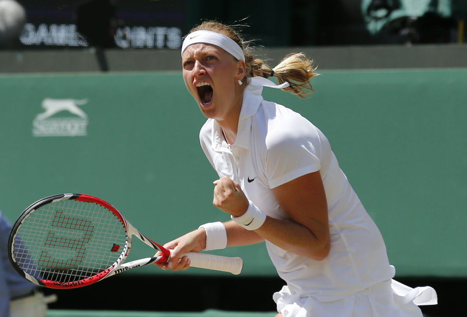 Photo - Petra Kvitova of Czech Republic celebrates winning the first set as she plays against Lucie Safarova of Czech Republic during their women's singles semifinal match at the All England Lawn Tennis Championships in Wimbledon, London, Thursday, July 3, 2014. (AP Photo/Ben Curtis)