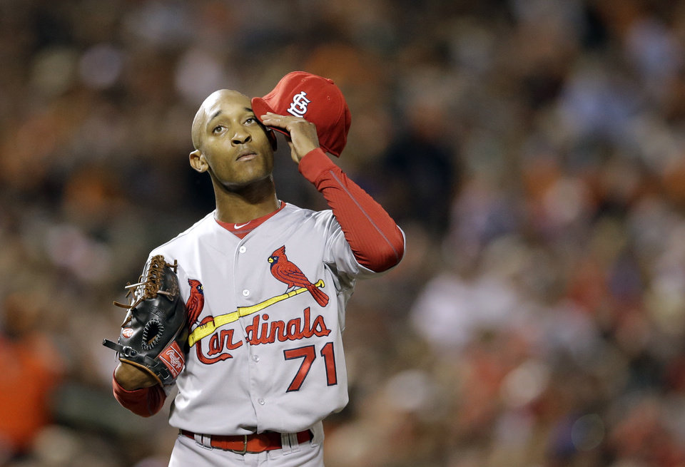 Photo - St. Louis Cardinals relief pitcher Sam Freeman pauses after hitting Baltimore Orioles' Adam Jones with a pitch to load the bases in the sixth inning of an interleague baseball game, Friday, Aug. 8, 2014, in Baltimore. Baltimore won 12-2. (AP Photo/Patrick Semansky)