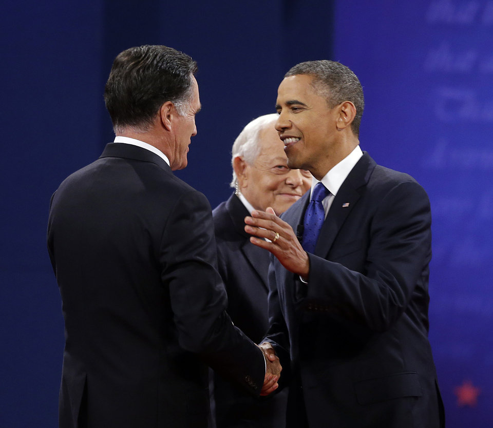 Photo -   Moderator Bob Schieffer, center, watches as Republican presidential candidate, former Massachusetts Gov. Mitt Romney and President Barack Obama shake hands before the start of the last debate at Lynn University, Monday, Oct. 22, 2012, in Boca Raton, Fla. (AP Photo/Pablo Martinez Monsivais)