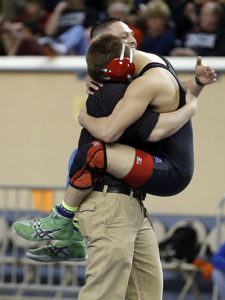 Photo - Chandler's Tanner Wall celebrates his win over Kingfisher's Brady Smith in the class with a Daniel Sullivan following the 3A 138-pound match during the Oklahoma State wrestling championships at the State Fair Arena, Saturday, March 1. 2014. Photo by Sarah Phipps, The Oklahoman