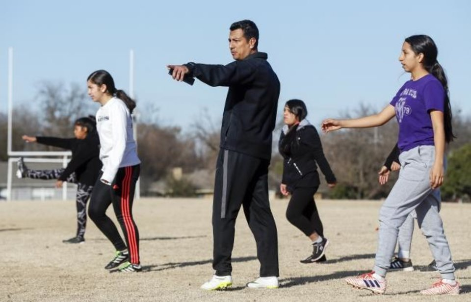 Photo -  Johnny Charqueño leads the team in warm-ups during soccer practice. [Nate Billings/The Oklahoman]