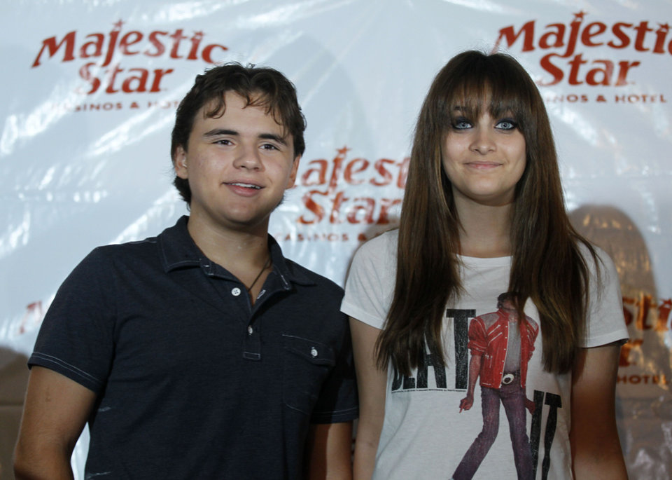 Photo -   Prince, left, and Paris Jackson, children of the late pop icon Michael Jackson, pose for photographers after an appearance at a Jackson tribute event Wednesday, Aug. 29, 2012, in Gary, Ind. Members of Michael's family are in the Northwestern Indiana city on what would have been Jackson's 54th birthday. (AP Photo/Charles Rex Arbogast)