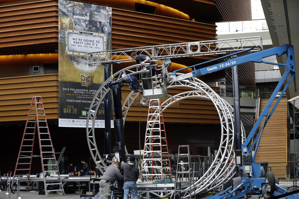 Photo - Workmen begin Preparations for the Philadelphia International Festival of the Arts 2013, at the Kimmel Center Tuesday, Feb. 19, 2013, in Philadelphia.  The citywide festival is scheduled to run from March 28 to April 27. (AP Photo/Matt Rourke)