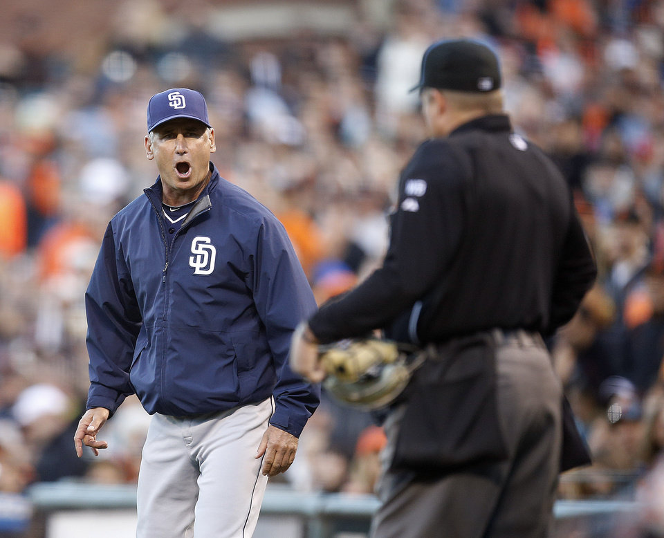 Photo - San Diego Padres manager Bud Black, agues with umpire Marvin Hudson after a call was overturned during the fourth inning against San Francisco Giants of a baseball game in San Francisco, Monday, June 23, 2014. Bud Black was thrown out of the game. (AP Photo/Tony Avelar)