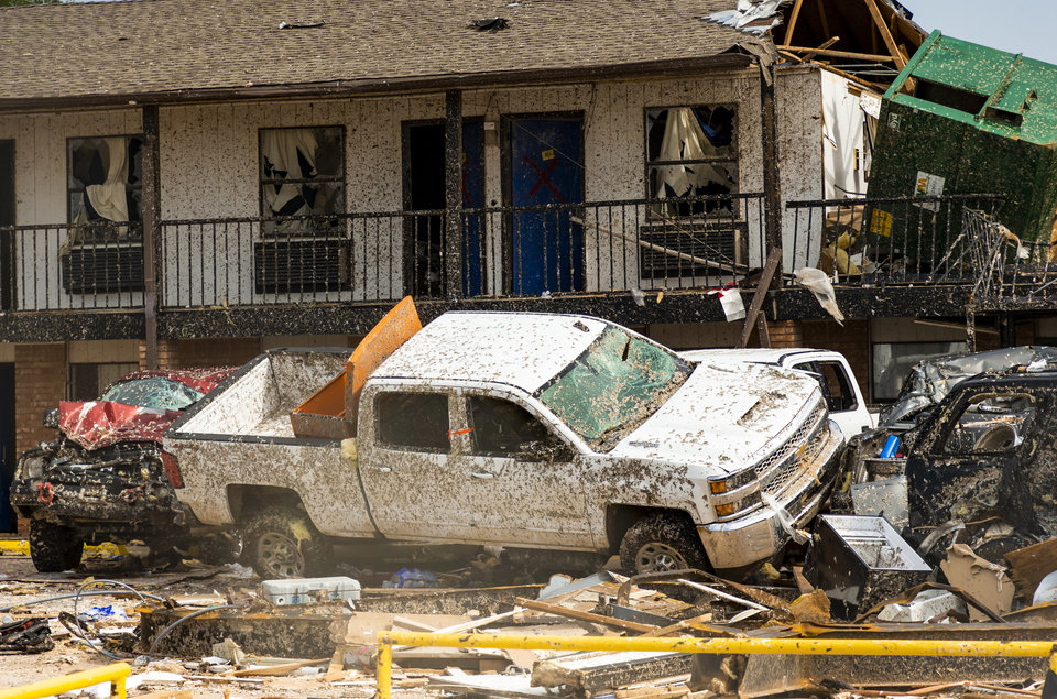 Photo - Storm damage and debris left behind at the American Budget Value Inn in the aftermath of a tornado in El Reno, Okla. on Monday, May 27, 2019.The EF3 tornado hit the area on Saturday night killing two people and injuring many others. [Chris Landsberger/The Oklahoman]