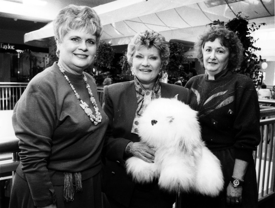 """""""Dixie Jensen, Patti Page and Dorothy Morrison, from left, wonder 'How Much Is That Doggie in The Window?'"""" Miss Page was in town for a pops concert with the Oklahoma Philharmonic Orchestra at the Civic Center Music hall, and took some time out during her visit to Oklahoma City to shop at 50 Penn Place with some Oklahoma Philharmonic Orchestra League members. Staff photo by Jim Argo taken 2/10/90; photo ran in the 2/14/90 and 5/13/90 Daily Oklahomans."""