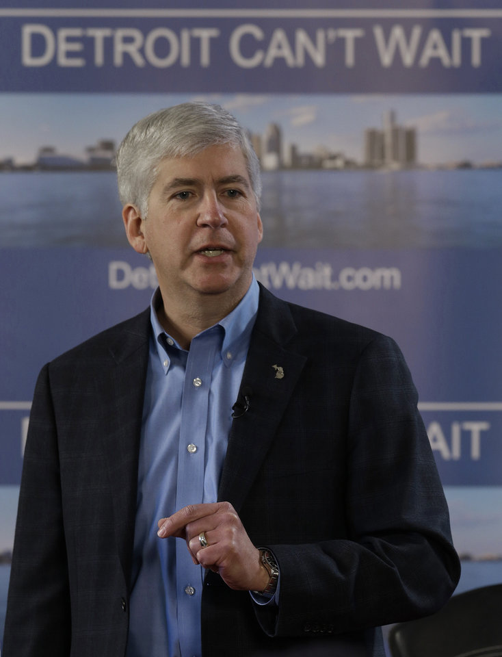Gov. Rick Snyder declares a financial emergency during a broadcast in Detroit, Friday, March 1, 2013. The determination could lead to the appointment of an emergency manager over the city's finances. (AP Photo/Paul Sancya)