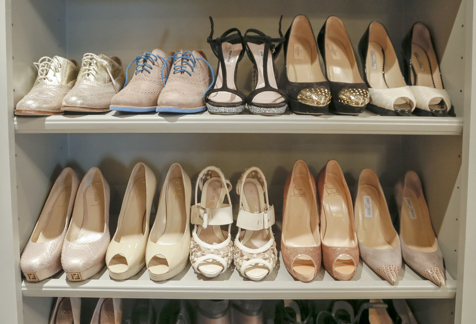 Photo - Keeping shoes in a designated space makes it easier to see what you've got. Photo by Chris Landsberger, The Oklahoman.  CHRIS LANDSBERGER