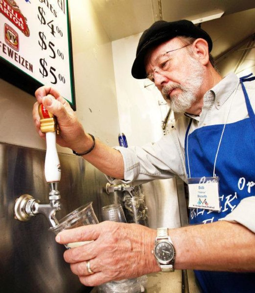 Photo - Bob Bozarth fills a cup with beer  on Friday, Sep. 9, 2011, during the 27th annual Greek Festival at St. George Greek Orthodox Church in far northwest Oklahoma City.  Bozarth, a member of the church, is a volunteer worker at the festival. Photo by Jim Beckel, The Oklahoman  ORG XMIT: KOD