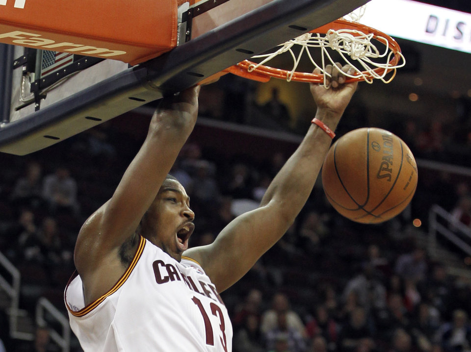 Cleveland Cavaliers\' Tristan Thompson dunks against the Washington Wizards during the second quarter in an NBA preseason basketball game Saturday, Oct. 13, 2012, in Cleveland. (AP Photo/Tony Dejak)