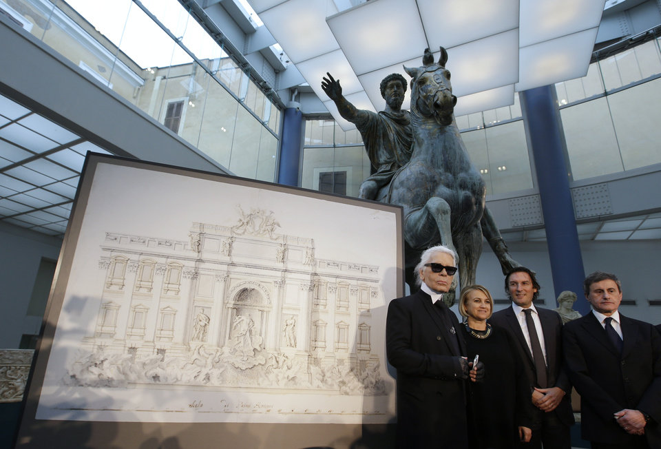 Photo - From left, Designer Karl Lagerfeld, Silvia Venturini Fendi, Fendi CEO Pietro Beccari and Rome's Mayor Gianni Alemanno, pose for photographers next to a drawing of the Trevi Fountain, in Rome, Monday, Jan. 28, 2013. The Fendi fashion house is financing an euro 2.12 million ($2.8 million) restoration of Trevi Fountain in Rome, famed as a setting for the film