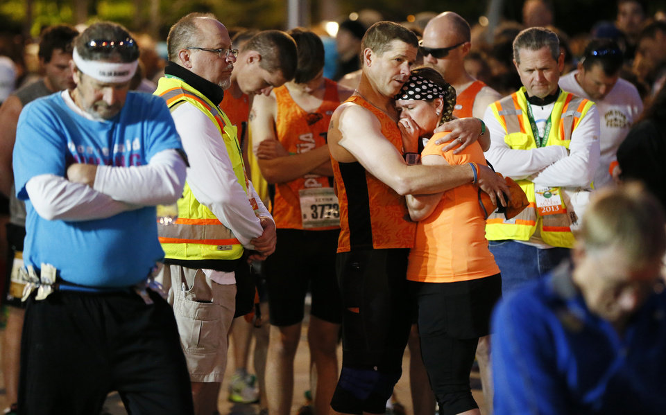 Runners and race officials pause for 168 seconds of silence to honor those killed in the 1995 bombing of the Alfred P. Murrah Federal Building,  before the start of the Oklahoma City Memorial Marathon in Oklahoma City, Sunday, April 28, 2013. Photo by Nate Billings, The Oklahoman