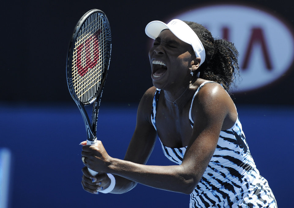 Photo - Venus Williams of the U.S.  reacts during her first round match against Ekaterina Makarova of Russia at the Australian Open tennis championship in Melbourne, Australia, Monday, Jan. 13, 2014. (AP Photo/Andrew Brownbill)
