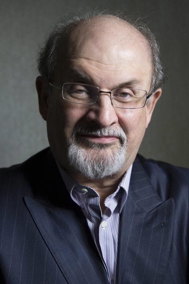 Photo - FILE - This Sept. 8, 2012 file photo shows author Salman Rushdie posing during the 2012 Toronto International Film Festival in Toronto. Rushdie is promoting the film adaptation of his breakthrough novel,