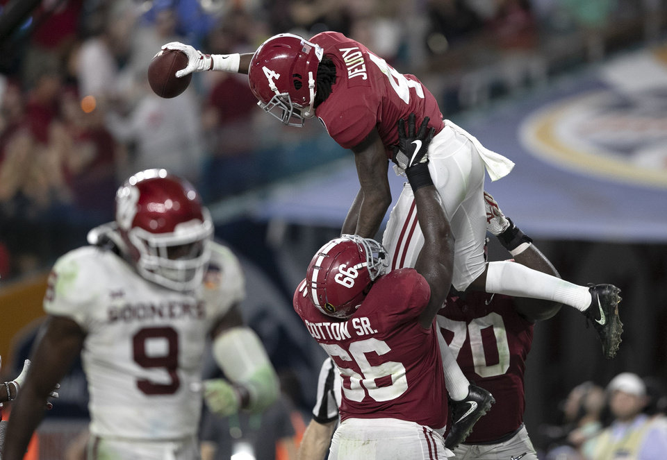 Photo - Alabama Crimson Tide wide receiver Jerry Jeudy (4) celebrates a touchdown catch in the fourth quarter withAlabama Crimson Tide offensive lineman Lester Cotton Sr. (66) and Alabama Crimson Tide offensive lineman Alex Leatherwood (70) in the College Football Playoff semifinals in the Orange Bowl at Hard Rock Stadium in Miami Gardens, Florida on December 29, 2018. [ALLEN EYESTONE/palmbeachpost.com]