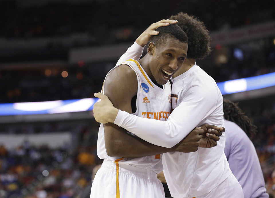 Photo - Tennessee guard Josh Richardson (1) embraces a teammate after the second half of an NCAA college basketball third-round tournament game against Mercer, Sunday, March 23, 2014, in Raleigh. Tennessee Won 83-63. (AP Photo/Gerry Broome)