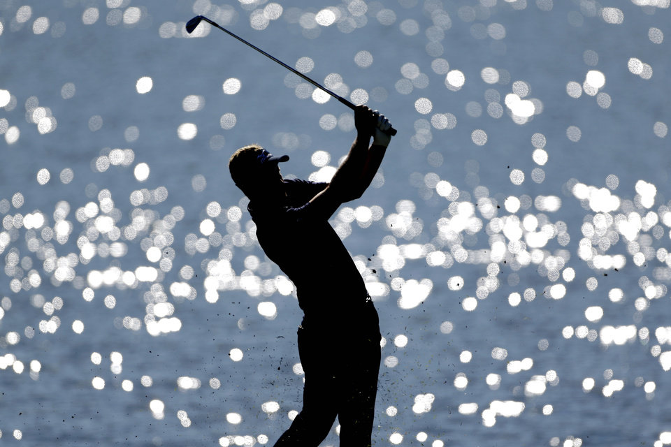 Photo -   Luke Donald, of England, hits off the fairway on the 17th hole during the final round of the Tour Championship golf tournament, Sunday, Sept. 23, 2012, in Atlanta. (AP Photo/David Goldman)