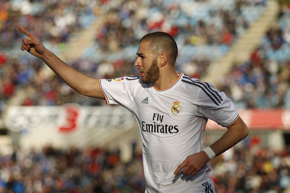 Photo - Real's Karim Benzema celebrates his goal during a Spanish La Liga soccer match between Real Madrid and Getafe at the Coliseum Alfonso Perez stadium in Madrid, Spain, Sunday, Feb. 16, 2014. (AP Photo/Gabriel Pecot)