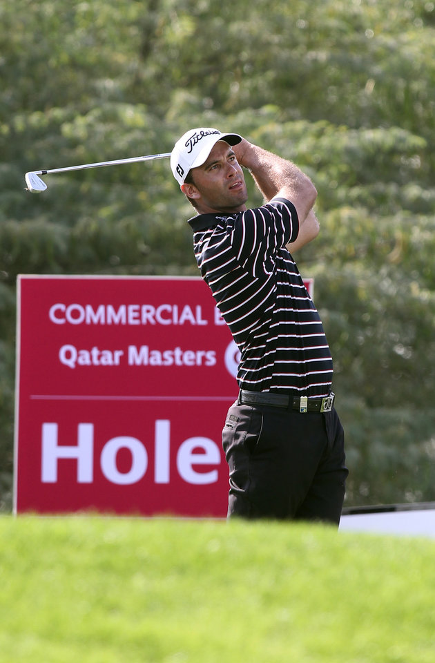 Photo - Ricardo Santos of Portugal plays his second shot on the 6 hole during the Second round of the Commercial Bank Qatar Masters held at Doha Golf Club in Qatar, Thursday, Jan. 24, 2013. (AP Photo/Osama Faisal)