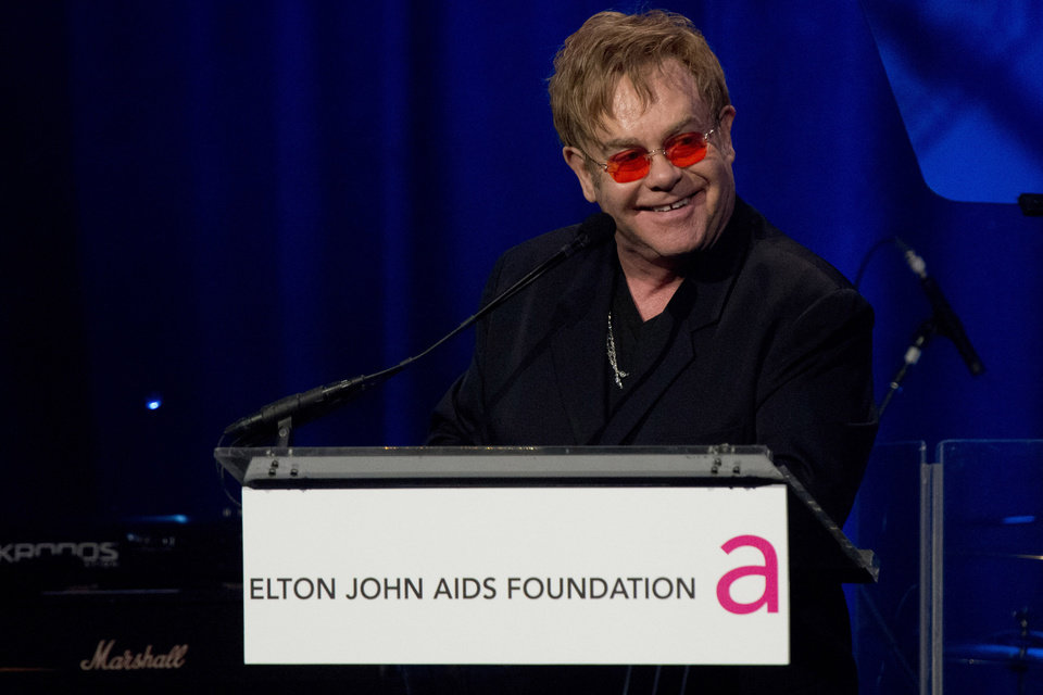 Elton John appears on stage at his AIDS Foundation\'s 11th annual Enduring Vision benefit on Monday, Oct. 15, 2012 in New York. (Photo by Charles Sykes/Invision/AP)