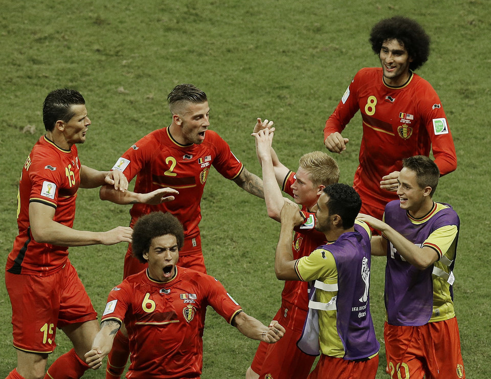 Photo - Belgium's Kevin De Bruyne, center right, celebrates scoring the opening goal during the World Cup round of 16 soccer match between Belgium and the USA at the Arena Fonte Nova in Salvador, Brazil, Tuesday, July 1, 2014. (AP Photo/Themba Hadebe)