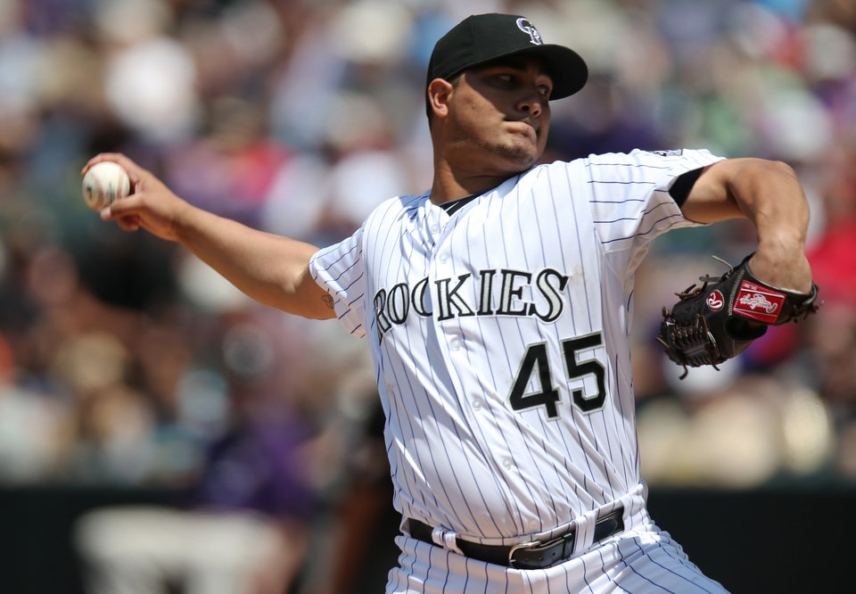 Photo - Colorado Rockies starting pitcher Jhoulys Chacin works against the Atlanta Braves in the fourth inning of a baseball game in Denver, Thursday, June 12, 2014. (AP Photo/David Zalubowski)