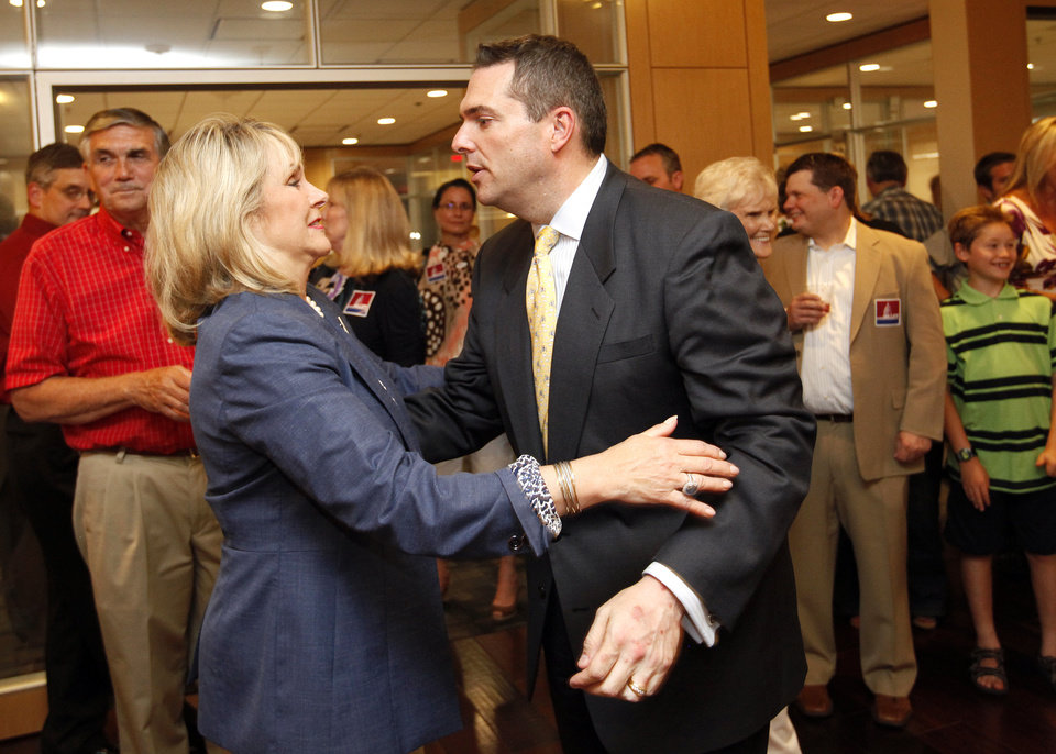 Photo - Sen. Clark Jolley is congratulated  Gov. Mary Fallin check results during a watch partty in Edmond, Okla. Tuesday, June 26, 2012. Photo by Sarah Phipps, The Oklahoman