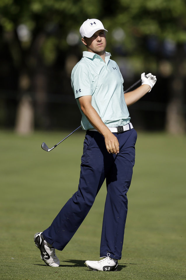 Photo - Jordan Spieth watches his shot into the 13th green during the second round of the Memorial golf tournament Friday, May 30, 2014, in Dublin, Ohio. (AP Photo/Darron Cummings)