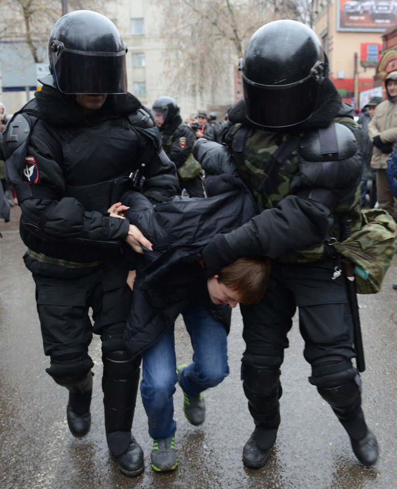Photo -   Riot policemen detain a participant of an opposition march in Nizhny Novgorod, about 400 km (200 miles) east of Moscow, on Sunday, Nov. 4, 2012. The march took place on Unity Day, a national holiday established in 2005 to replace commemorations of Bolshevik Revolution. (AP photo/ Mitya Aleshkovskiy)