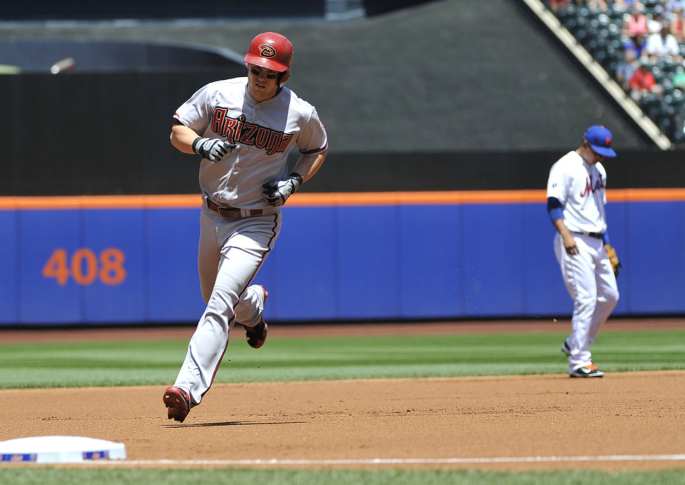 Photo - Arizona Diamondbacks' Chris Owings, rounds third base after hitting a solo home run off in the first inning of game one in a double header baseball game at Citi Field on Sunday, May 25, 2014, in New York. (AP Photo/Kathy Kmonicek)
