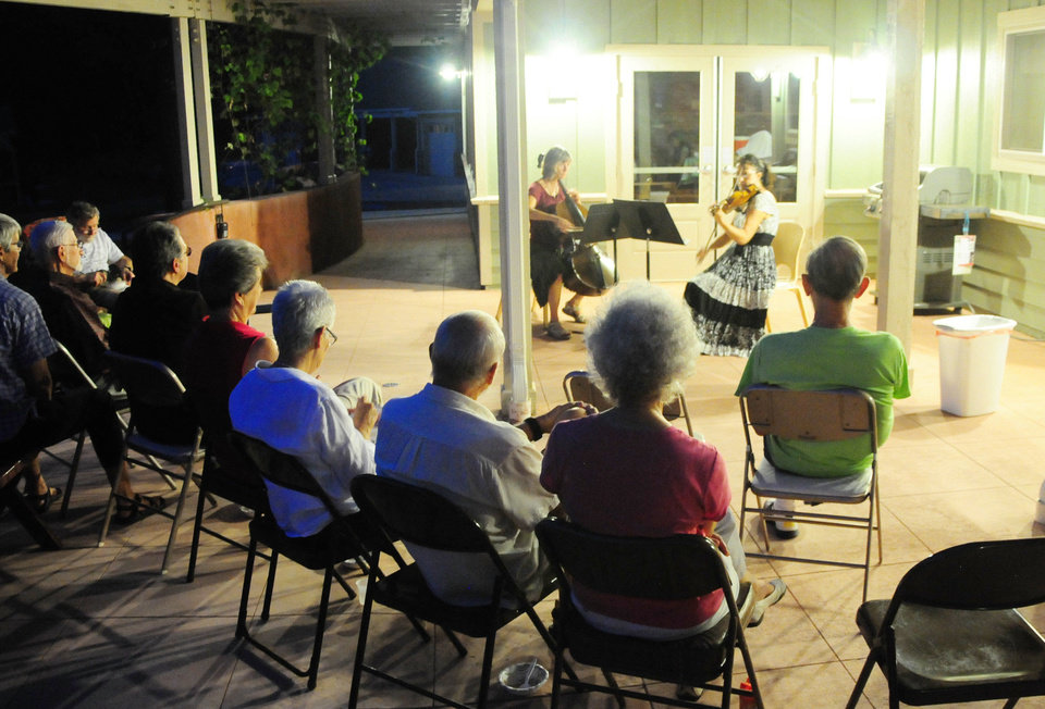 Residents of the Oakcreek Cohousing Community gather for a night of music and socialization as a community on Sept. 12, 2013 in Stillwater, Okla. Photo by KT King/For the Oklahoman