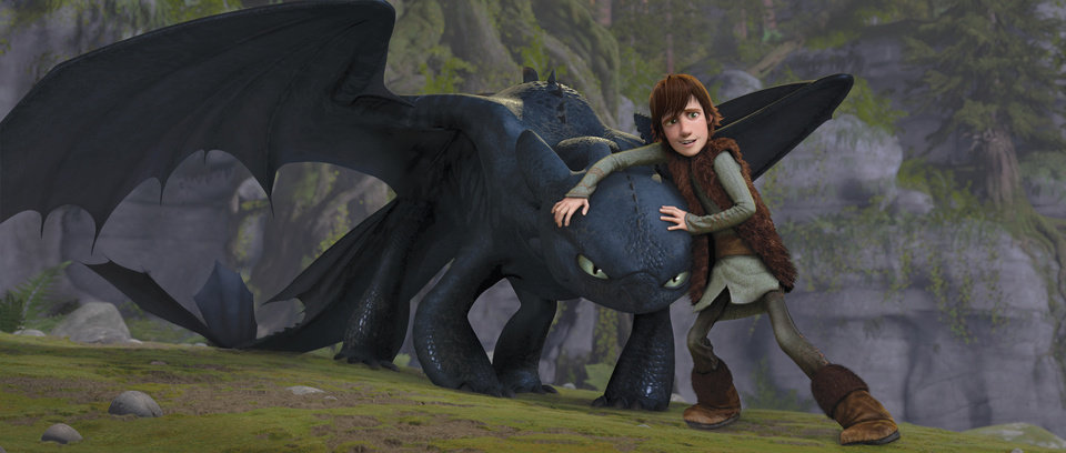 "Photo - Teenage Viking Hiccup (Jay Baruchel) befriends Toothless, an injured Night Fury — the most feared and mysterious dragon breed — in ""How to Train Your Dragon."" - DreamWorks Animation Photo