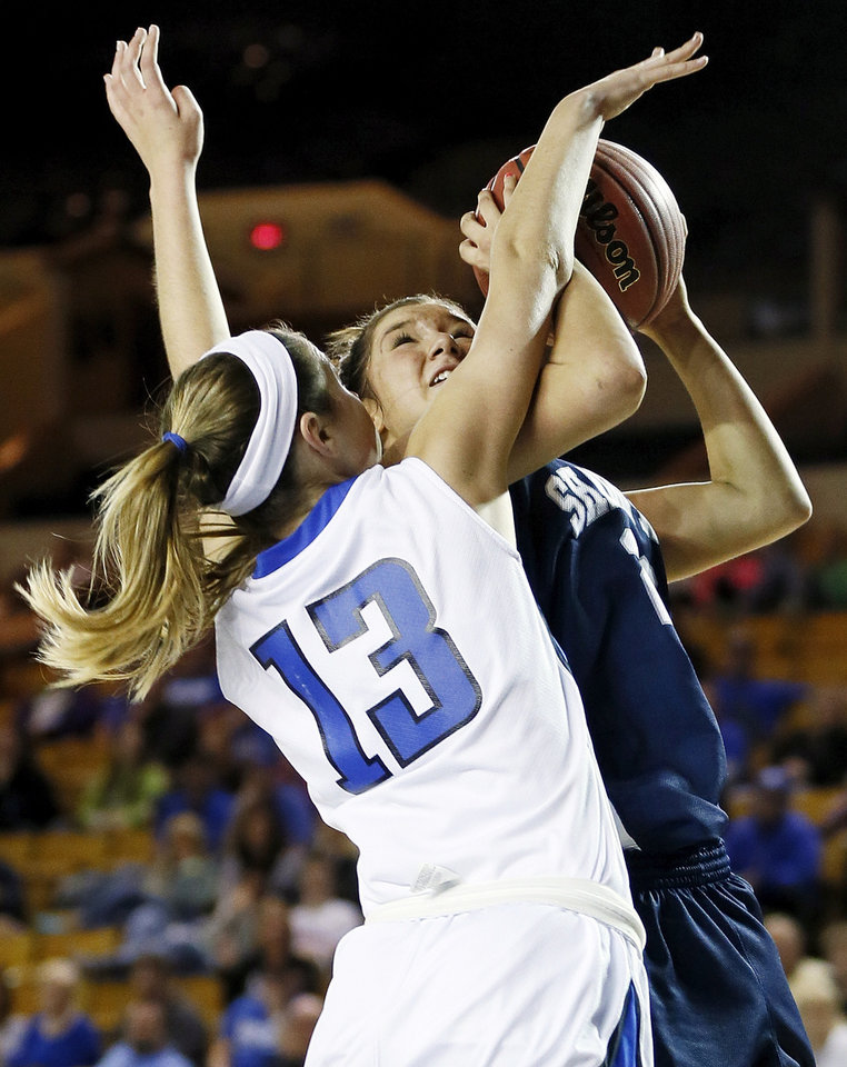 Deer Creek's Whitney Jones (13) fouls Shawnee's Bailey Taylor (20) during the Class 5A girls championship high school basketball game in the state tournament at the Mabee Center in Tulsa, Okla., Saturday, March 9, 2013. Photo by Nate Billings, The Oklahoman