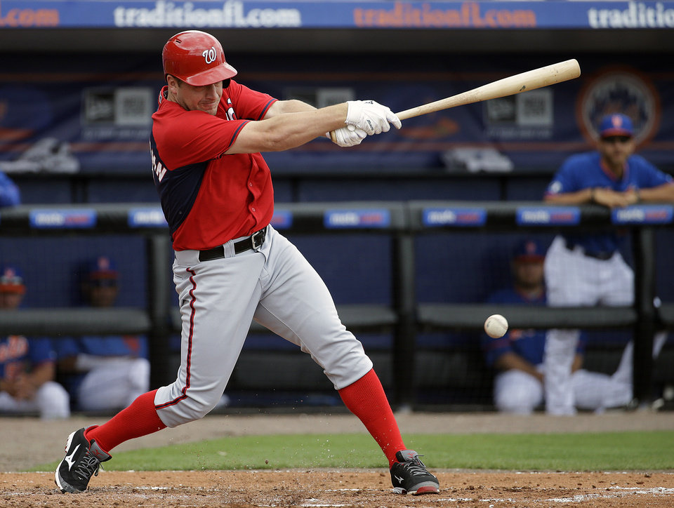 Photo - Washington Nationals' Jordan Zimmermann singles to score teammate Wilson Ramos in the second inning of an exhibition spring training baseball game against the New York Mets, Thursday, March 27, 2014, in Port St. Lucie, Fla. (AP Photo/David Goldman)