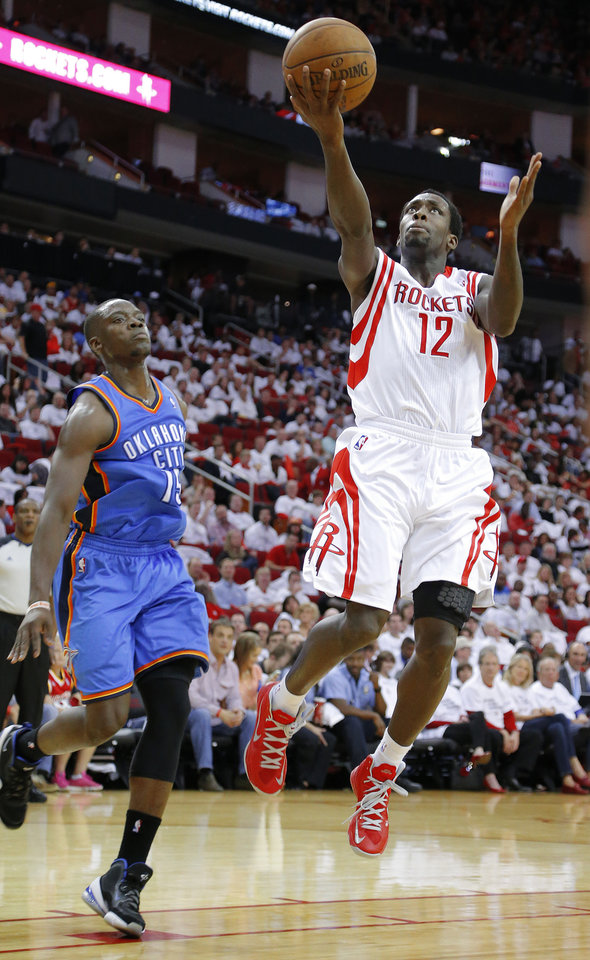 Houston\'s Patrick Beverley (12) goes past Oklahoma City\'s Reggie Jackson (15) during Game 3 in the first round of the NBA playoffs between the Oklahoma City Thunder and the Houston Rockets at the Toyota Center in Houston, Texas, Sat., April 27, 2013. Oklahoma City 104-101. Photo by Bryan Terry, The Oklahoman