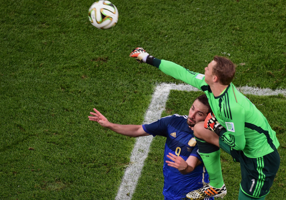Photo - Germany's goalkeeper Manuel Neuer collides with Argentina's Gonzalo Higuain during the World Cup final soccer match between Germany and Argentina at the Maracana Stadium in Rio de Janeiro, Brazil, Sunday, July 13, 2014. (AP Photo/Francois Xavier Marit, Pool)
