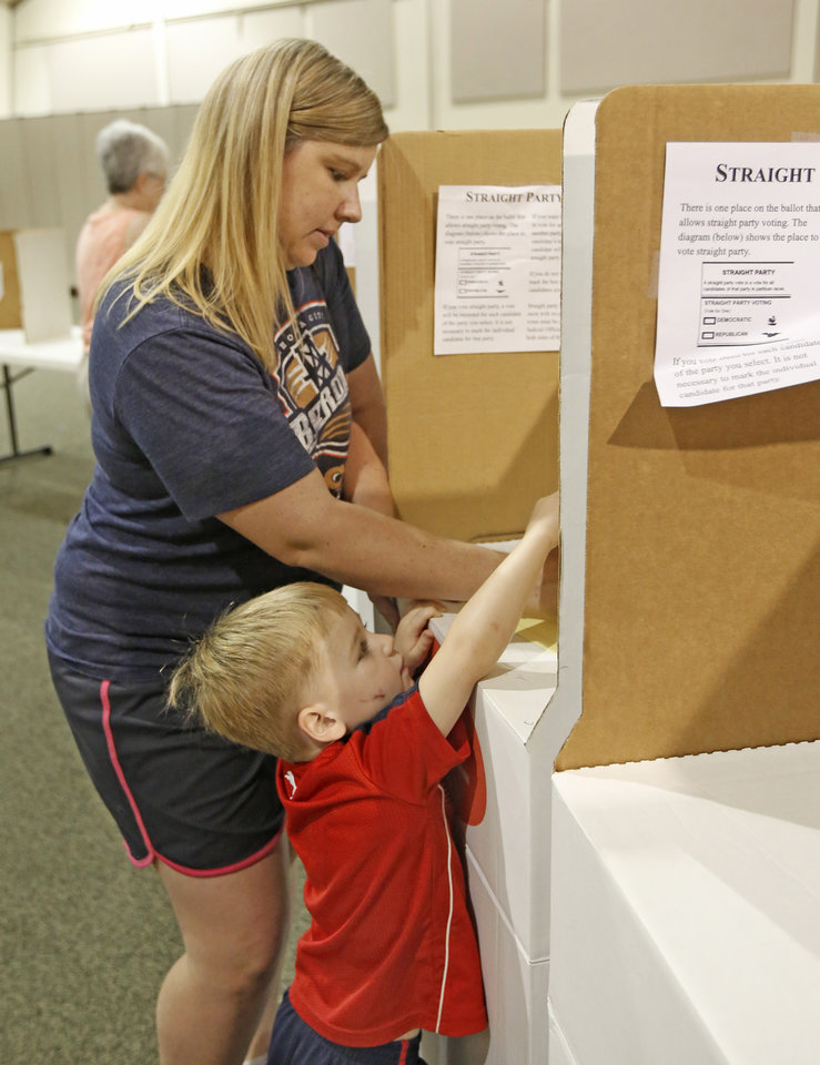 Photo - Dana Israel votes with her son, Blake, 3,  at Church of Christ South Yukon, Tuesday June, 28  2016. Photo By Steve Gooch, The Oklahoman
