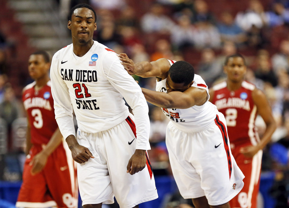 San Diego State\'s Jamaal Franklin (21) gets a shove from Chase Tapley (22) while celebrating a play in front of Oklahoma\'s Buddy Hield (3) and Steven Pledger (2) during a game between the University of Oklahoma and San Diego State in the second round of the NCAA men\'s college basketball tournament at the Wells Fargo Center in Philadelphia, Friday, March 22, 2013. San Diego State beat OU, 70-55. Photo by Nate Billings, The Oklahoman