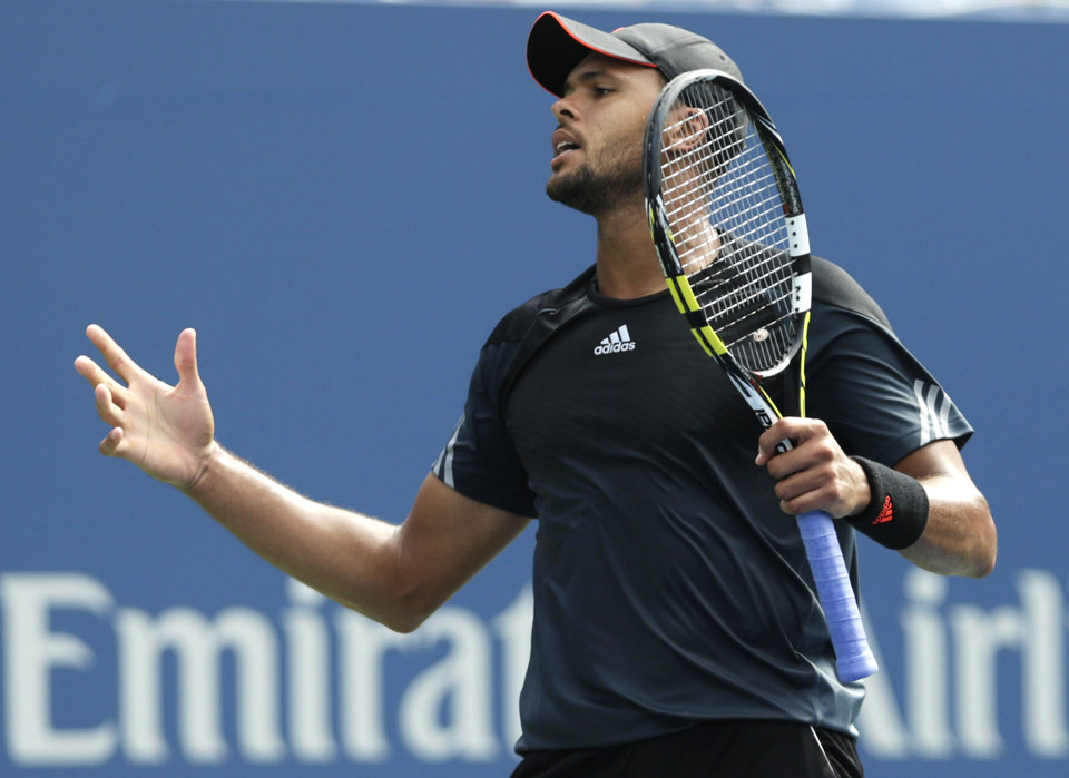Photo - Jo-Wilfried Tsonga, of France, reacts after a shot against Andy Murray, of the United Kingdom, during the fourth round of the 2014 U.S. Open tennis tournament, Monday, Sept. 1, 2014, in New York. (AP Photo/Charles Krupa)