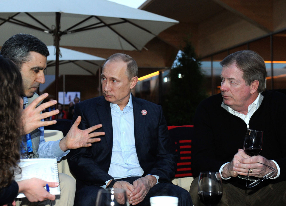 Photo - Russian President Vladimir Putin, center, speaks with Head of the NBC Olympic Department Gary Zenkel, left, and member of the International Olympic Committee Larry Probst, right,  while visiting USA House during the 2014 Winter Olympics, Friday, Feb. 14, 2014 in Sochi, Russia.  (AP Photo/RIA-Novosti, Mikhail Klimentyev, Presidential Press Service)